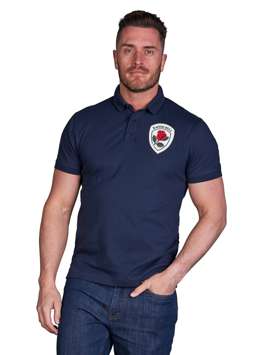 model wearing high quality crested navy polo shirt